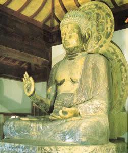 วัดทิศตะวันตกพระพุทธรูปพระโพธิสัตว์ทำด้วยไม้ยาว